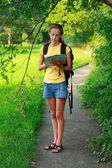 Woman tourist with map in hand — Stock Photo