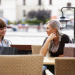 Two young woman chatting - Stock Photo