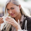 Woman drinking a cup of tea - Stock Photo