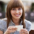woman alone in a cafe — Stock Photo