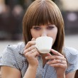 Woman alone drinking a cup of tea — Stock Photo