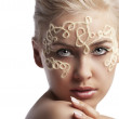 Blonde girl with a wool string on her face — Stock Photo #6254486