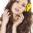 Fresh girl with flower in hair — Stock Photo