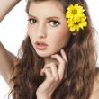Stock Photo: Fresh girl with yellow flower in hair