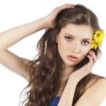 Fresh girl with yellow flower — Stock Photo