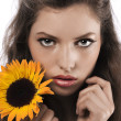 Face shot of a pretty girl holding a sunflower — Stock Photo #6255332