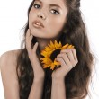 Beautiful girl posing with a sunflower — Stock Photo #6255427