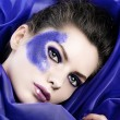 Beautiful girl in the middle of purple fabric — Stock Photo