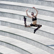 Jumping dancer in arena — Stockfoto