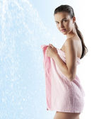 Pretty young model with pink towel — Stock Photo