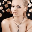 Beautiful blond girl with necklace — Stock Photo