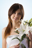 Beauty girl with lily — Stock Photo