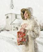 Girl and christmas present bag — Stock Photo