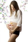 Pregnant with butterfly — Stock Photo