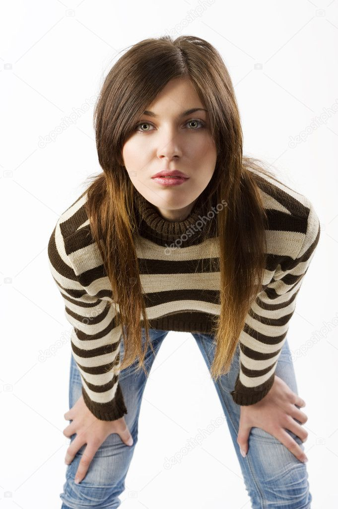 Studio shot portrait of young cute brunette wearing a brown and white sweater — Stock Photo #6275467