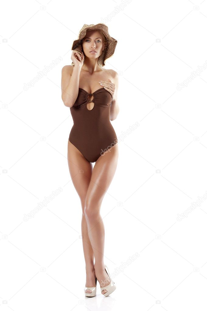 Stunning young woman wearing a brown swimsuit and a summer hat posing  Stock Photo #6277149