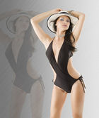 Brunette in black swimsuit — Stock Photo