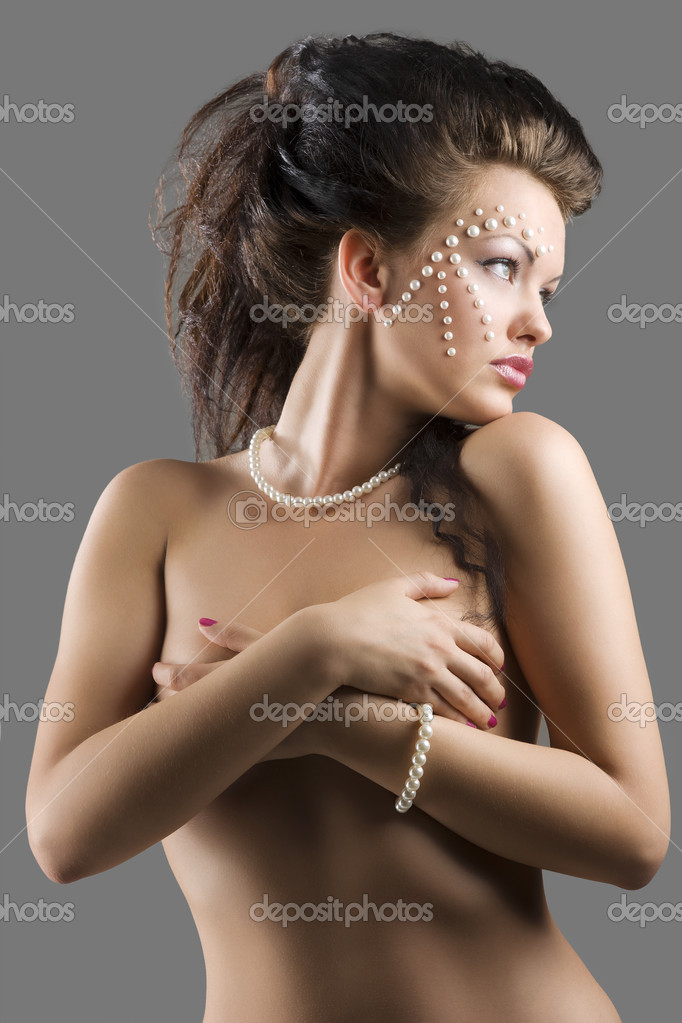 Elegant and sexy young naked woman with hair style and beautiful fashion ...