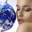 Blond with creative make up an shining ball - Foto Stock