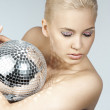 Blond with creative make up an shining ball — Stock Photo #6317665