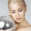 Blond with creative make up an shining ball — Stock Photo #6317681