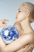 Blond with creative make up an shining ball — Stock Photo