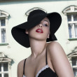 Blue-eyed beautiful blonde wearing hat and bra on the backgrou — Stock Photo #6370120