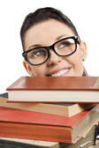 Student with glasses behind books — Stock Photo