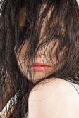Brunette covering face with hair — Stock Photo