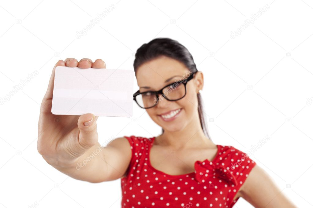 Smiling young woman in red dress showing a card . focus in the business card — Stock Photo #6533598