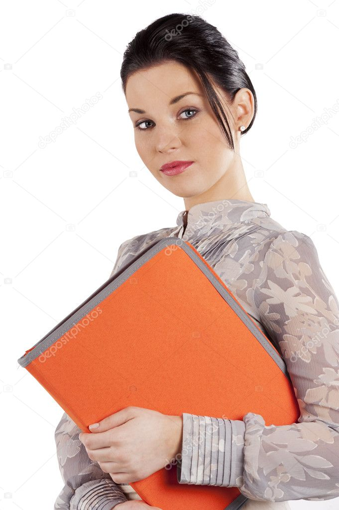 Elegant young brunette business woman with an orange folder over white  Stock Photo #6533728
