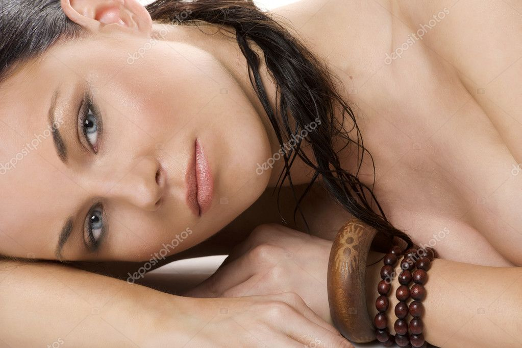 Close up porrait of beauty brunette woman with ethnic accessory looking in camera — Stock Photo #6533992
