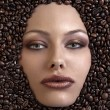 Pretty girl's face immersed in coffee beans — Stock Photo