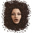 Stock Photo: Face shot of immersed girl in coffee beans