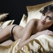 Sexy naked girl between pillow — Stock Photo #6707697