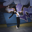 Royalty-Free Stock Photo: Modern dancer girl and graffiti