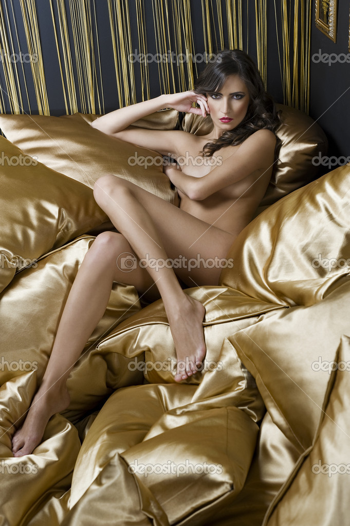 stock photo sexy naked girl between pillow