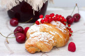 Croissant with berries — Stock Photo