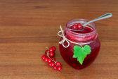 Glass pot of currant jam — Stock Photo