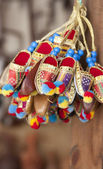 Set of miniature decorative shoes — Stock Photo