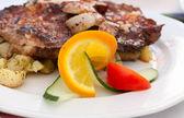 Fried steak with potatos — Stockfoto