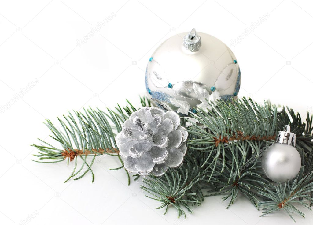 Pine branch and christmas silver decorations over white — Stock Photo #6459138