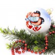 Christmas decorations and spruce twig — Stock Photo