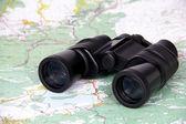 Binoculars and map — Stock Photo