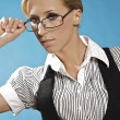 Businness woman portrait, holding a glasses. — Stock Photo