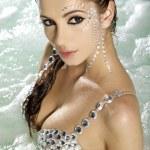 Beautiful brunette in swimmingpool — Stock Photo #5442351