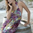 Beautiful brunette woman in romantic summer dress - Stockfoto