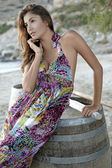 Beautiful brunette woman in romantic summer dress — Stock Photo