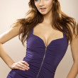 Sexy brunette posing in violet dress. — Stock Photo #5579928