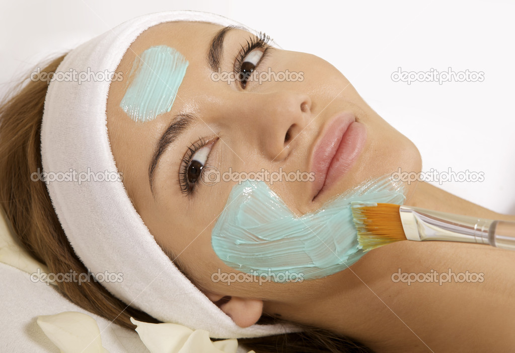 Young woman getting beauty skin mask treatment on her face with brush — Stock Photo #5579735